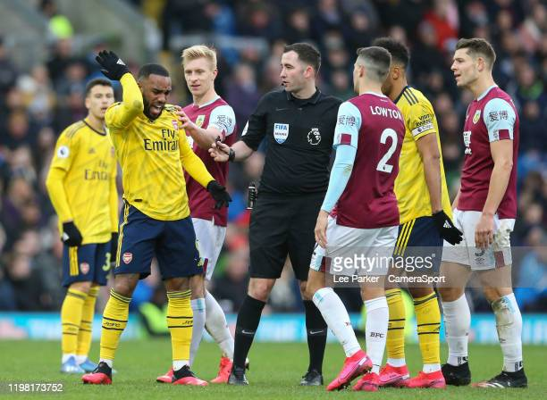 Arsenal's Alexandre Lacazette is unhappy and appeals to Referee Chris Kavanagh after a challenge from Burnley's James Tarkowski with Burnley's Ben...
