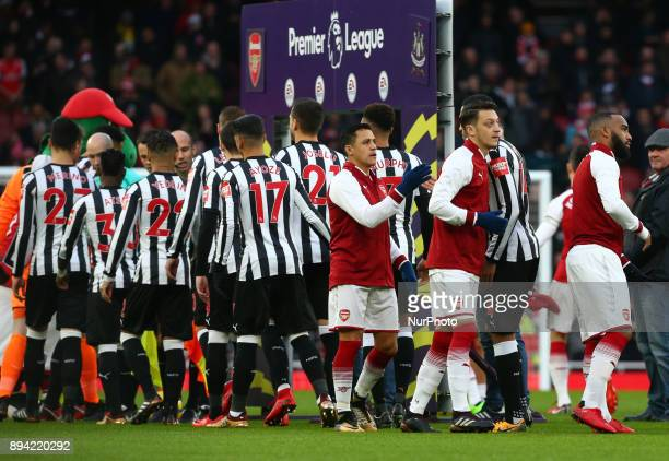 LR Arsenal's Alexis Sanchez and Arsenal's Mesut Ozil during Premier League match between Arsenal and Newcastle United at The Emirates London 16 Dec...