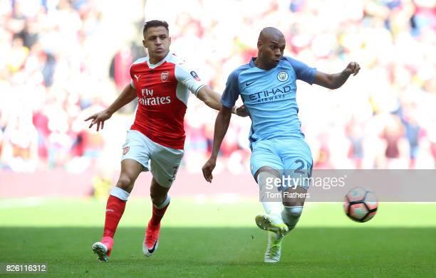 Arsenal's Alexis Sanchez and Manchester City's Fernandinho battle for the ball