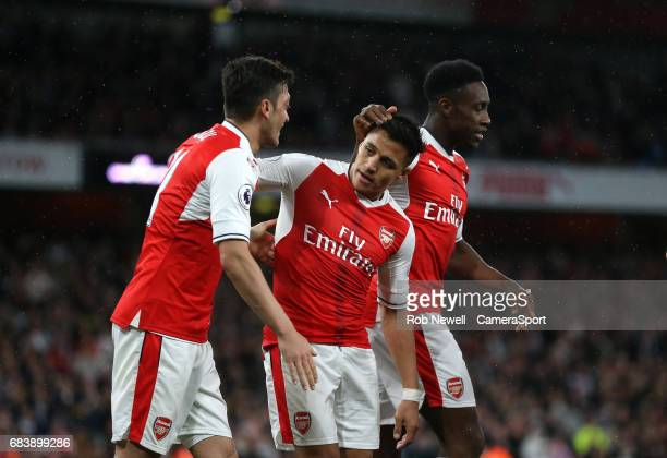 Arsenal's Alexis Sanchez is congratulated by after scoring his side's first goal during the Premier League match between Arsenal and Sunderland at...