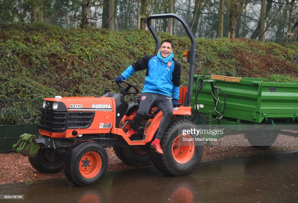 Arsenal's Alexis Sanchez jumps on a tractor after a training session at London Colney on January 2, 2018 in St Albans, England.