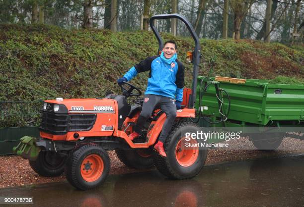 Arsenal's Alexis Sanchez jumps on a tractor after a training session at London Colney on January 2 2018 in St Albans England