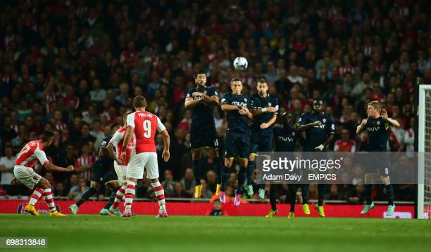 Arsenal's Alexis Sanchez scores the first goal from a free kick