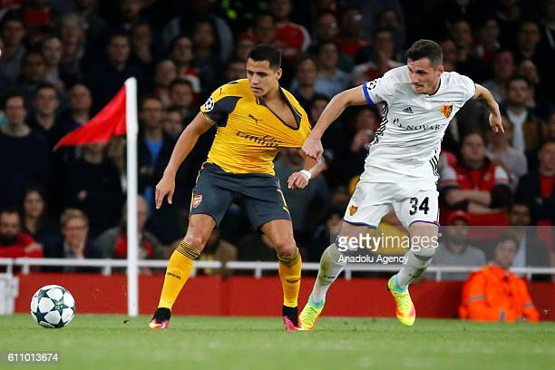 Arsenals Alexis Sanchez vies with Basel's Taulant Xhaka during Champions League Group A match between Arsenal FC and FC Basel at Emirates Stadium on...
