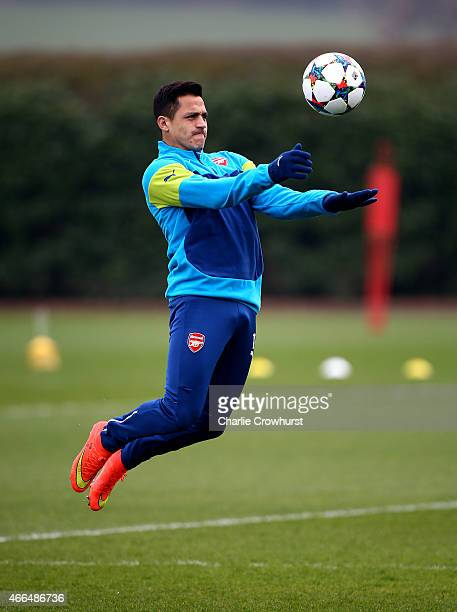 Arsenal's Alexis Sanchez warms up during the Arsenal Training Session ahead of their Champions League match against AS Monaco on March 16 2015 in St...