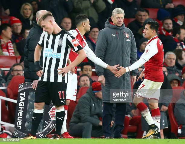 Arsenal's Alexis Sanchez whilst Arsenal manager Arsene Wenger look on during Premier League match between Arsenal and Newcastle United at The...