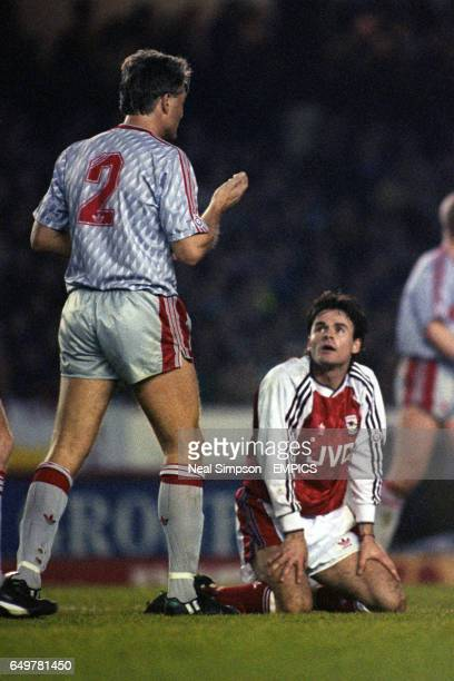 Arsenals' Anders Limpar looks up at Liverpool's Glenn Hysen after being brought down for a penalty