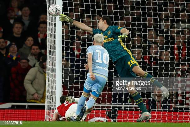 Arsenal's Argentinian goalkeeper Emiliano Martinez makes a save during the English FA Cup third round football match between Arsenal and Leeds United...