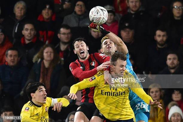 Arsenal's Argentinian goalkeeper Emiliano Martinez punches the ball clear during the English FA Cup fourth round football match between Bournemouth...