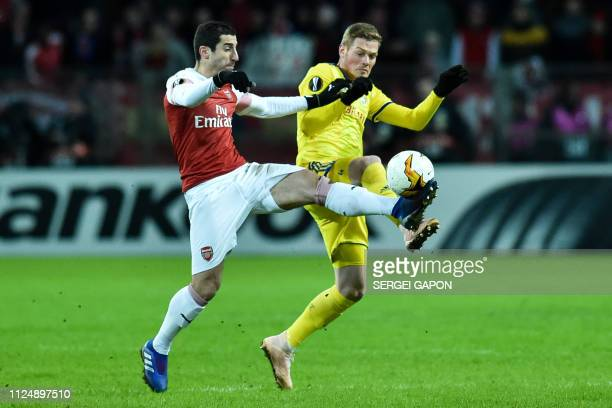 Arsenal's Armenian midfielder Henrikh Mkhitaryan and BATE Borisov's Serbian defender Aleksandar Filipovic vie for the ball during the UEFA Europa...