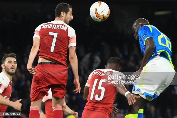 Arsenal's Armenian midfielder Henrikh Mkhitaryan and Napoli's Senegalese defender Kalidou Koulibaly go for a header during the UEFA Europa League...