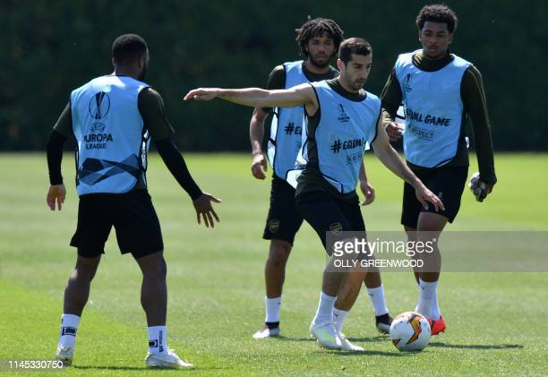 Arsenal's Armenian midfielder Henrikh Mkhitaryan attends a team training session at Arsenal's London Colney training centre in St. Albans on May 21,...