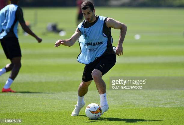 Arsenal's Armenian midfielder Henrikh Mkhitaryan attends a training session at Arsenal's Colney training centre in St. Albans on May 21, 2019 ahead...