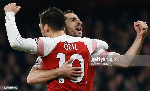 Arsenal's Armenian midfielder Henrikh Mkhitaryan celebrates scoring his team's second goal with Arsenal's German midfielder Mesut Ozil during the...