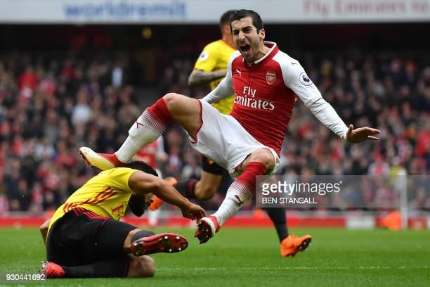 TOPSHOT Arsenal's Armenian midfielder Henrikh Mkhitaryan reacts to a challenge from Watford's Englishborn Jamaican defender Adrian Mariappa during...