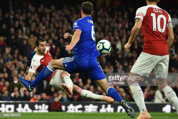 Arsenal's Armenian midfielder Henrikh Mkhitaryan shoots past Leicester City's Northern Irish defender Jonny Evans but is unsuccessful during the...