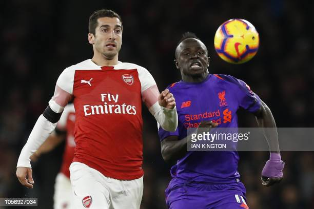 TOPSHOT Arsenal's Armenian midfielder Henrikh Mkhitaryan vies with Liverpool's Senegalese striker Sadio Mane during the English Premier League...