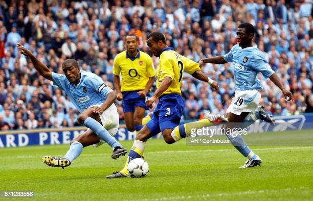 Arsenal's Ashley Cole is tackled by Manchester City's Sylvian Distin and Shaun WrightPhilips during their Premiership clash at the Manchester Stadium...