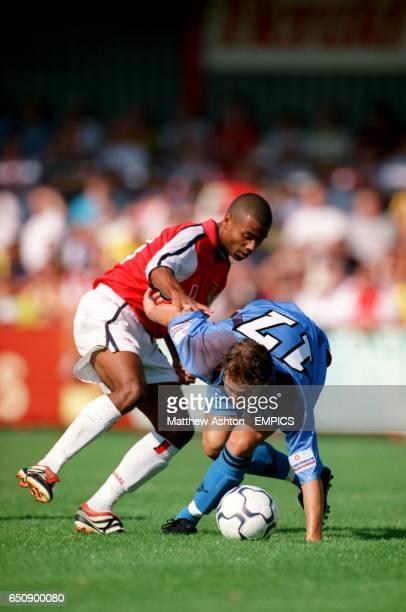 Arsenal's Ashley Cole tusstles with Stevenage Borough's Robert Miller
