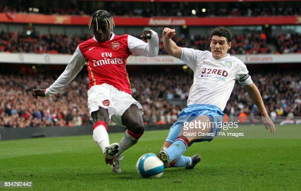 Arsenal's Bacary Sagna is tackled by Aston Villa's Gareth Barry during the Barclays Premier League match at Emirates Stadium, London.