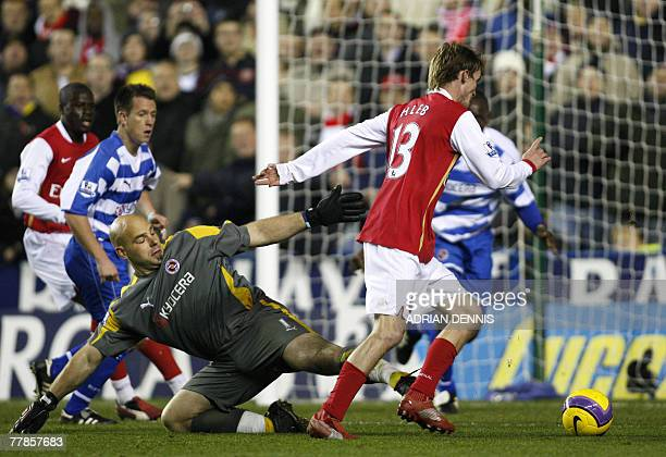 Arsenal's Belarusian player Alexander Hleb prepares to shoot past Reading's goalkeeper Marcus Hahnemann to score their second goal during the...