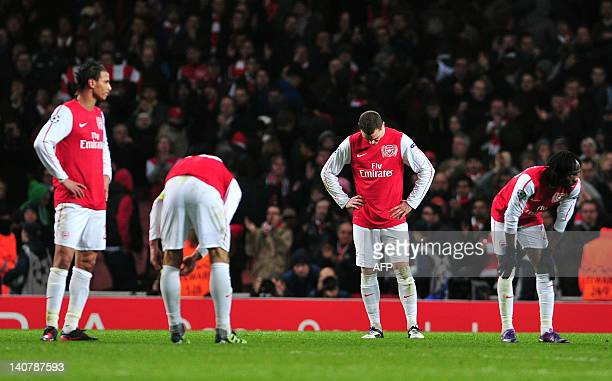 Arsenal's Belgian defender Thomas Vermaelen shows his disappointment after an UEFA Champions League round of 16 second leg football match against AC...