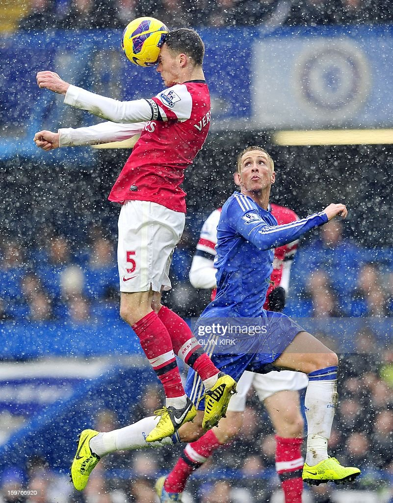 """Arsenal's Belgian defender Thomas Vermaelen (L) vies with Chelsea's Spanish striker Fernando Torres (R) during their English Premier League football match at Stamford Bridge in London, England on January 20, 2013. AFP PHOTO/Glyn KIRK - RESTRICTED TO EDITORIAL USE. No use with unauthorized audio, video, data, fixture lists, club/league logos or """"live"""" services. Online in-match use limited to 45 images, no video emulation. No use in betting, games or single club/league/player publications."""