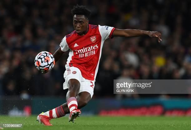 Arsenal's Belgian midfielder Albert Sambi Lokonga crosses the ball during the English Premier League football match between Arsenal and Crystal...
