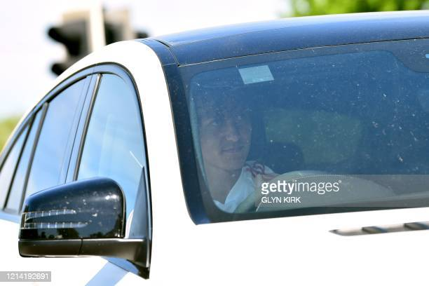 Arsenal's Brazilian defender David Luiz arrives at at Arsenal's Colney training centre north of London on May 20 2020 as training continues for...