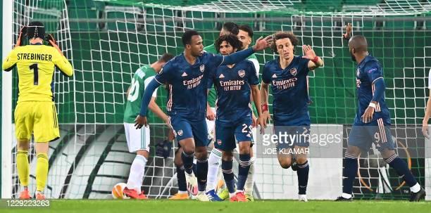 Arsenal's Brazilian defender David Luiz celebrates scoring with team mates during the UEFA Europa League Group B football match Rapid Wien v Arsenal...