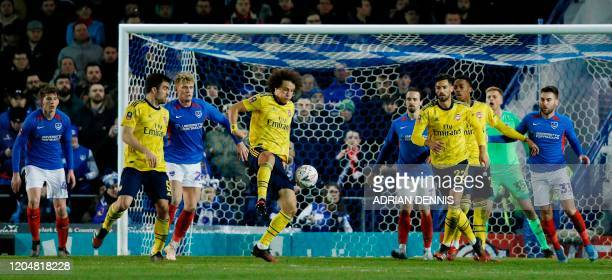 Arsenal's Brazilian defender David Luiz controls the ball during the English FA Cup fifth round football match between Portsmouth and Arsenal at...