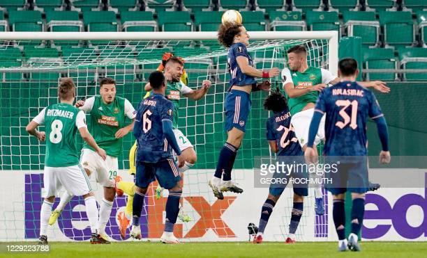 Arsenal's Brazilian defender David Luiz heads the ball to score during the UEFA Europa League Group B football match Rapid Wien v Arsenal in Vienna,...