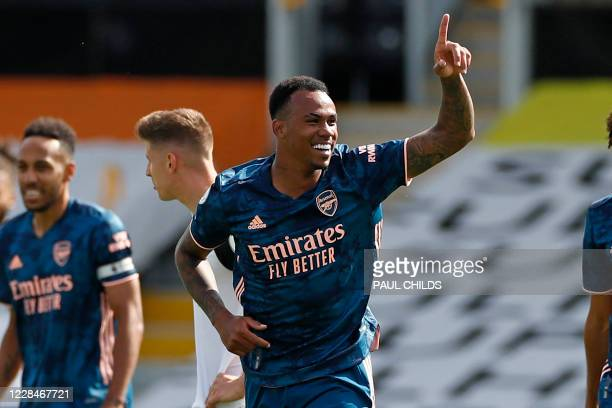 Arsenal's Brazilian defender Gabriel celebrates after scoring their second goal during the English Premier League football match between Fulham and...