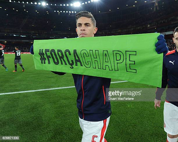 Arsenal's Brazilian defender Gabriel holds a banner in rememberance for the members of the Chapecoense players and staff before the EFL Quarter Final...