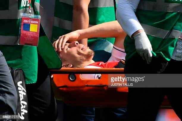 Arsenal's Brazilian defender Gabriel is stretchered off injured during the English Premier League football match between Arsenal and Everton at the...