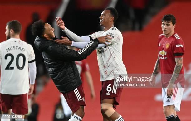 Arsenal's Brazilian defender Gabriel jokes with Arsenal's Gabonese striker Pierre-Emerick Aubameyang at the end of the English Premier League...