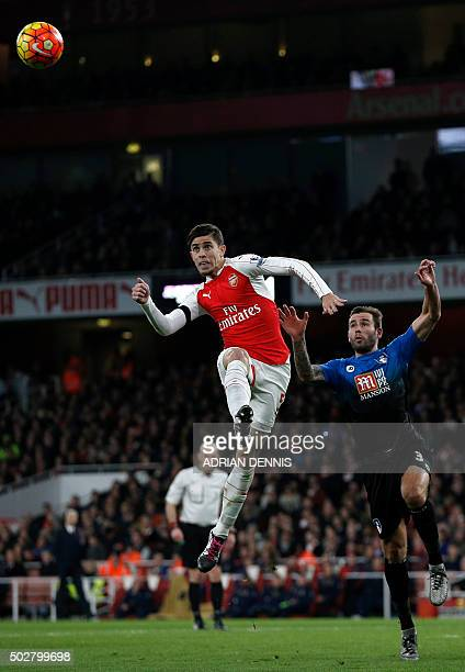 Arsenal's Brazilian defender Gabriel jumps to head the ball under pressure from Bournemouth's English defender Steve Cook during the English Premier...