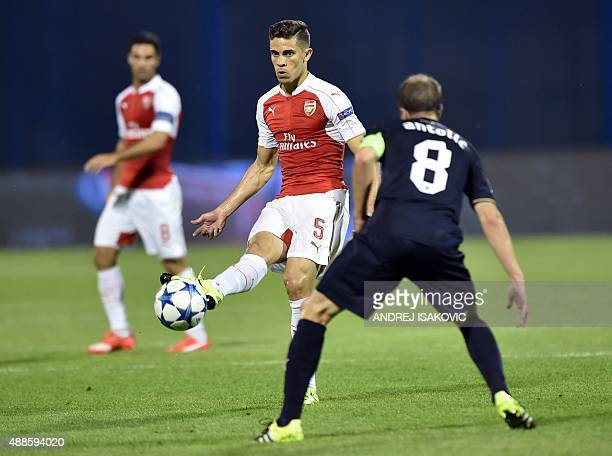 Arsenal's Brazilian defender Gabriel Paulista vies with Dinamo Zagreb's Croatian midfielder Domagoj Antolic during the UEFA Champions League Group F...