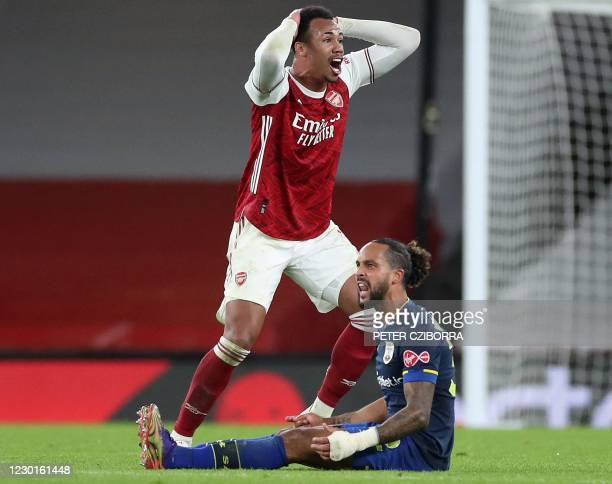 Arsenal's Brazilian defender Gabriel reacts as he realises he is about to receive a red card from Referee Paul Tierney for his foul on Southampton's...