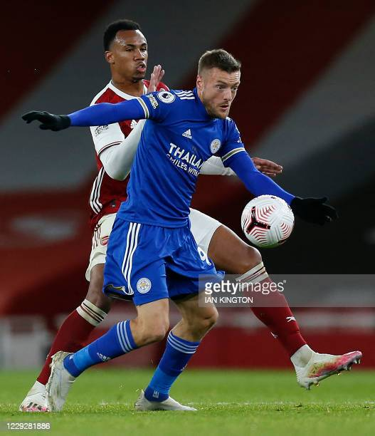 Arsenal's Brazilian defender Gabriel vies with Leicester City's English striker Jamie Vardy during the English Premier League football match between...