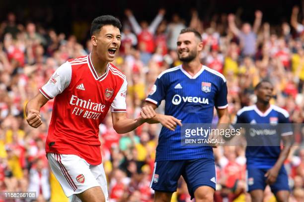 Arsenal's Brazilian striker Gabriel Martinelli celebrates scoring but his goal is later disallowed during the preseason friendly football match for...