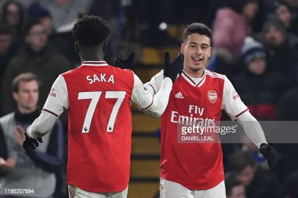 Arsenal's Brazilian striker Gabriel Martinelli celebrates scoring their first goal to equalise 11 with Arsenal's English striker Bukayo Saka during...