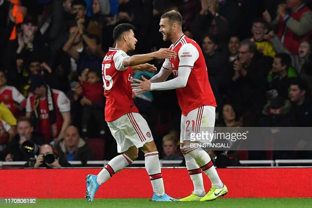Arsenal's Brazilian striker Gabriel Martinelli celebrates scoring the opening goal during the English League Cup third round football match between...