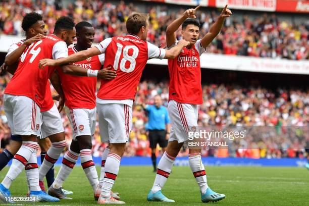 Arsenal's Brazilian striker Gabriel Martinelli celebrates with teammates after scoring but his goal is later disallowed during the preseason friendly...