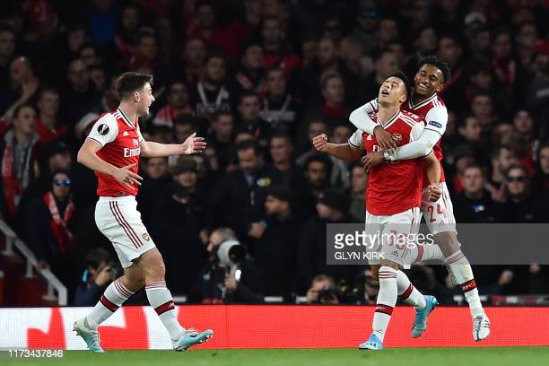 Arsenal's Brazilian striker Gabriel Martinelli celebrates with teammates after scoring his second goal during the UEFA Europa League Group F football...