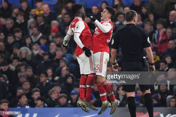 Arsenal's Brazilian striker Gabriel Martinelli celebrates with Arsenal's English striker Bukayo Saka after scoring the equalising goal during the...