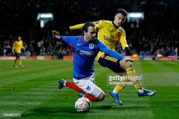 Arsenal's Brazilian striker Gabriel Martinelli challenges Portsmouth's Australian midfielder Ryan Williams during the English FA Cup fifth round...