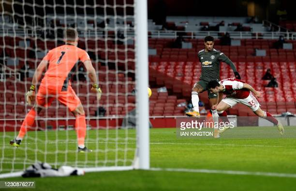 Arsenal's Brazilian striker Gabriel Martinelli heads the ball out of the path of Manchester United's English striker Marcus Rashford during the...