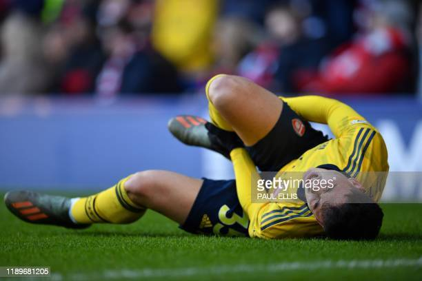 Arsenal's Brazilian striker Gabriel Martinelli lies injured on the pitch during the English Premier League football match between Everton and Arsenal...