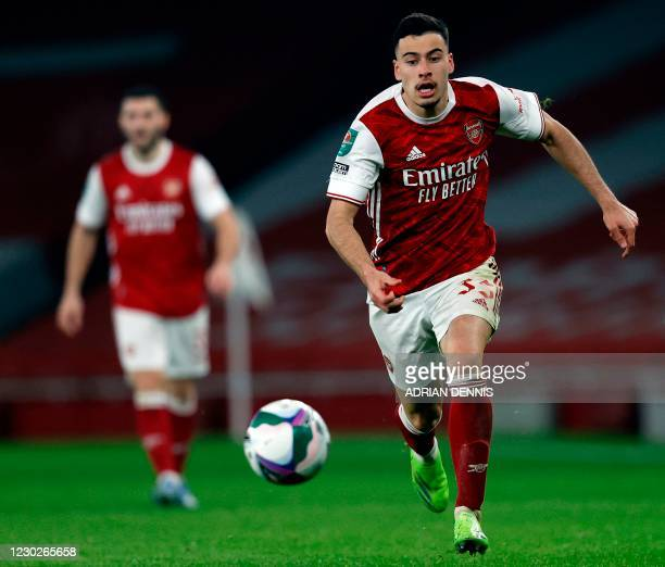 Arsenal's Brazilian striker Gabriel Martinelli runs with the ball during the English League Cup quarter final football match between Arsenal and...